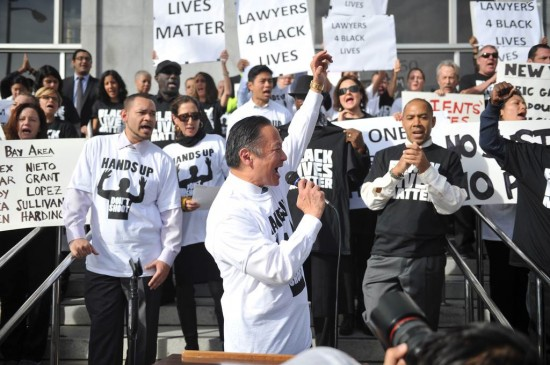 San Francisco Public Defender speaks at a rally in front of the criminal courthouse.