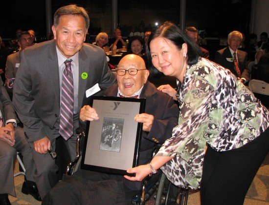 Fred Hoshiyama receives a lifetime achievement award from Rodney Chin, executive director of the BuchananYMCA, and Kathy Cheng, CFO of YMCA of San Francisco.