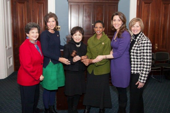 Outgoing chairs of the Congressional Caucus for Women's Issues pass the gavel to the new leadership team. From left: Reps. Lois Frankel (D-Fla.), Kristi Noem (R-S.D.), Doris Matsui (D-Sacramento), Donna Edwards (D-Md.), Jaime Herrera Beutler (R-Wash.), Susan Brooks (R-Ind.).