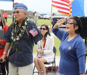"""Don Seki, a past Legion of Honor recipient, sings the """"442 Fight Song"""" with hula accompaniment by Lynette Seki Takahashi."""