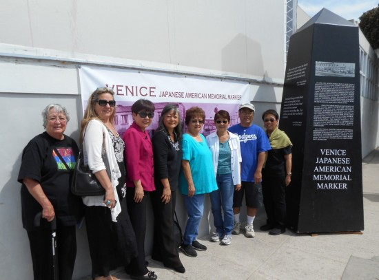 Pictured with a full-size model of the Venice Japanese American Memorial Marker are (form left) Emily Winters, VJAMM Committee and Venice Arts Council Suzanne Thompson, VJAMM Committee and Endangered Arts Committee of the VAC Esther Chaing, Hama Sushi Restaurant, Venice, California, donor of over $7,500.00 to the VJAMM Committee from the bento and dinner fundraisers in 2012, 2013, and 2014.   Phyllis Hayashibara, VJAMM Committee and former Venice High School teacher Judy Nawa, Venice Hongwanji Buddhist Temple Buddhist Women's Association Aya Masada, Venice Hongwanji Buddhist Temple Buddhist Women's Association Edd Hayashibara, brother-in-law of Phyllis and watcher of the VJAMM model June Fujioka, Venice Hongwanji Buddhist Temple Buddhist Women's Association