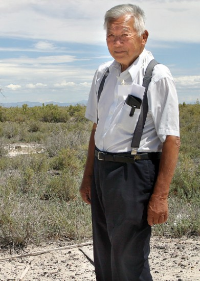 While visiting the Topaz concentration camp site in 2010, Ken Yoshida stands at the spot where his former barracks once stood during World War II. He was the oldest of three brothers who challenged the draft. (Photo courtesy of Martha Nakagawa)