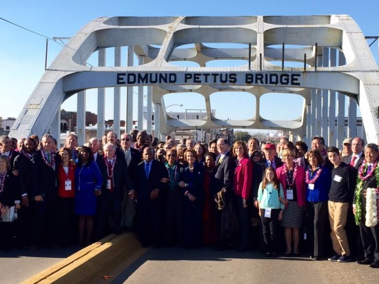 """Members of Congress gather at the Pettus Bridge in Selma, Ala., the site of """"Bloody Sunday"""" 50 years ago. (Office of Rep. Mark Takano)"""