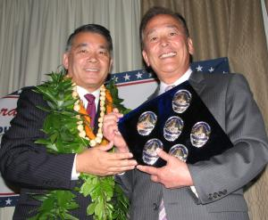 """Terry Hara receives a """"blue diamond"""" containing his LAPD badges from Gerald Fukui."""