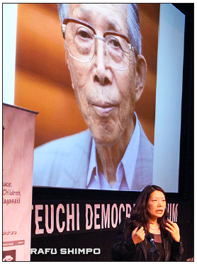 Dr. Akiko Mikamo with a photo of her father, a Hiroshima survivor.