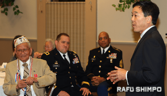 Gardena Mayor Paul Tanaka speaks at the Bronze Star ceremony for 442nd veteran Noboru Kagawa in April 2012. (MARIO G. REYES/Rafu Shimpo)