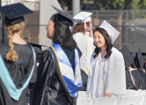 Elise Takahama in cap and gown for the South Pasadena High School commencement on June 11. She is heading to Boston University in the fall. (MIKEY HIRANO CULROSS/Rafu Shimpo)