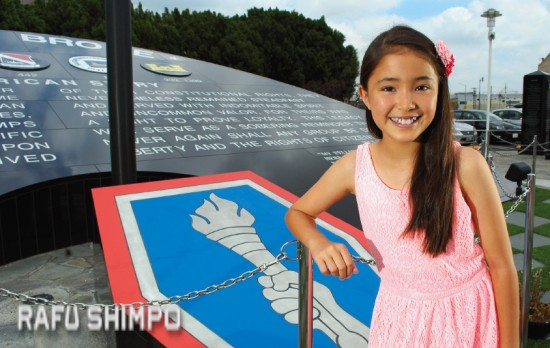 """Jodie Kiyokawa pays a visit to the Go For Broke Monument in Little Tokyo. The 11-year-old from Hawaii will appear in this weekend's """"Peace on Your Wings"""" as well as an upcoming film about wartime internment. (MIKEY HIRANO CULROSS/Rafu Shimpo)"""