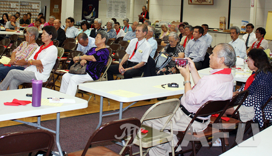 A crowd listens to speakers during the meeting held Tuesday at Centenary United Methodist Church.