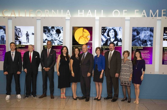 Gov. Jerry Brown and First Lady Anne Gust Brown (center) with the ninth class of California Hall of Fame inductees (from left): Robert Downey Jr., David Hockney, Lester Holt, Shannon Lee (representing Bruce Lee), Ellen Ochoa, John Owens (representing Buck Owens), Jean Schulz (representing Charles Schulz) and Kristi Yamaguchi. (Photo credit: Joe McHugh/California Highway Patrol)