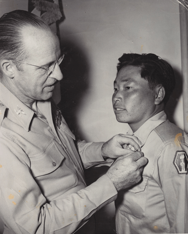 Col. Joseph Campbell pins the Distinguished Service Cross on Pvt. George Sakato in June 1945.