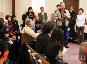 Reporters and members of the public ask questions about the pending Keiro sale at Thursday's press conference.