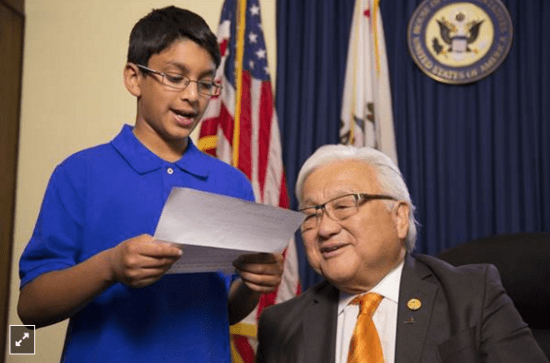 In Frank Chi's film, Rep. Mike Honda listens as a Muslim American student reads a letter written by a Japanese American student incarcerated during World War II.