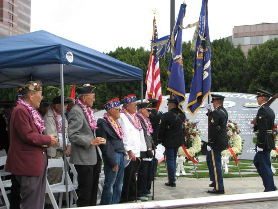 Nisei veterans stand at attention as the colors are posted in front of the Go For Broke Monument.