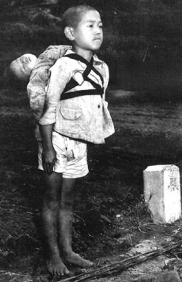 The horror of nuclear weapons is captured in this photo by Marine Sgt. Joe O'Donnell of a young boy standing in line at a cremation pit.