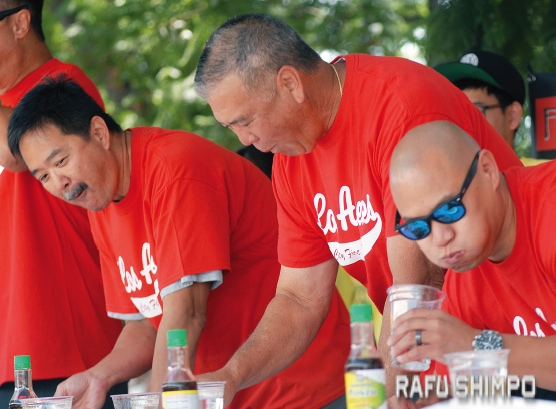 From left, Masa Matsuura, David Yamahata and David Tu compete for the L.A. Fire Department in their chow-off against the LAPD.
