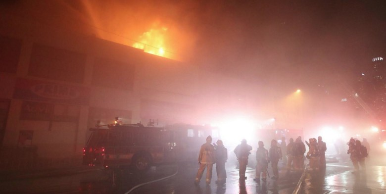 Flames shoot out of the roof of SmokeTokes on Third near San Pedro. (LAFD)