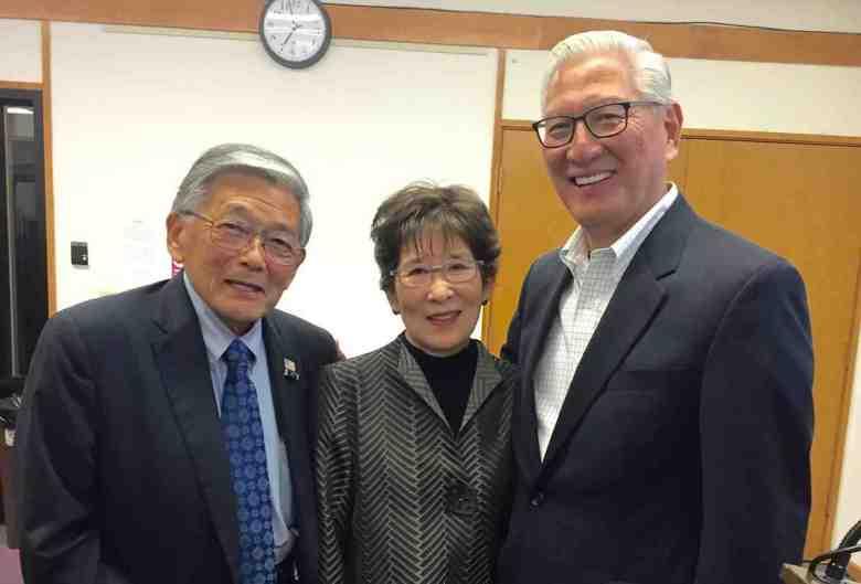 Former Secretary of Transportation Norman Mineta with Honda supporters Pat and Allen Okamoto.