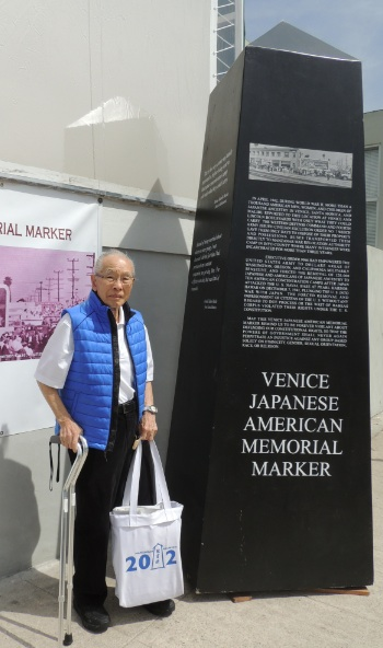 Arnold Maeda with a full-scale model of the VJAMM in 2014.