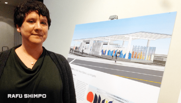 Clare Rojas displays drawings of the artwork she will create for the Regional Connector station.