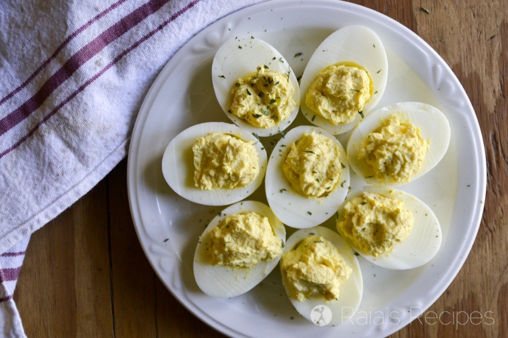 Kick that regular deviled eggs recipe up a notch with these Sour Cream & Sriracha Deviled Eggs made quick and easy in the Instant Pot!   RaiasRecipes.com