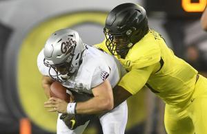 Oregon's Kayvon Thibodeaux (#5) brings down Montana quarterback Dalton Sneed for one of his nine sacks in 2019. Photo Credit: Mark Ylen- Mid-Valley Media