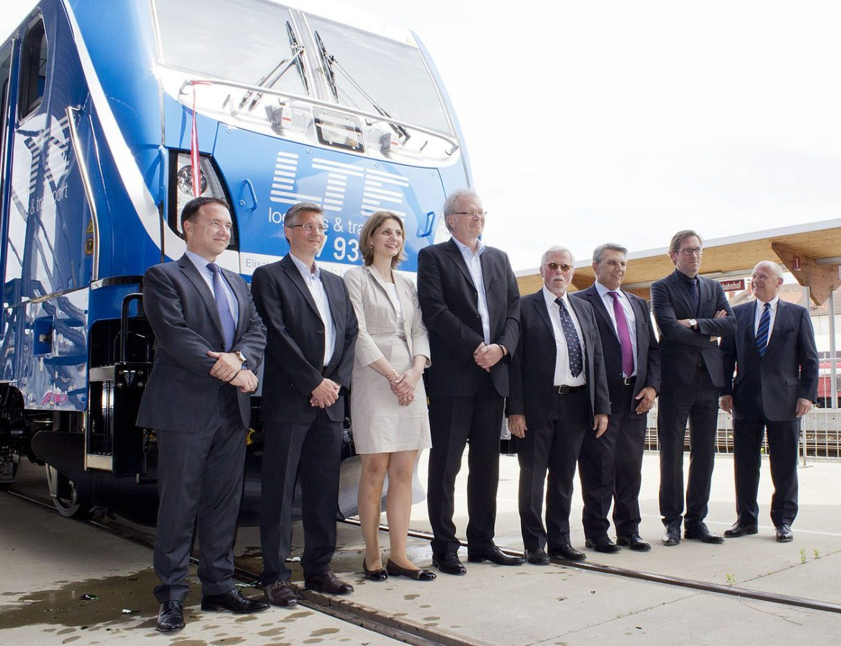 From left Michael Baier (CEO LTE), Michael Benda (CFO LTE), Mag. Elisabeth Landrichter (godmother of the locomotive), Andreas Mandl (CEO LTE), Dr. Karl Johann Hartig (Bombardier Transportation), Mag. Franz Weintögl (general manager GKB), Guy Degrave (Bombardier Transportation), Hubert Mierka (Danubian port Krems). - Copyright Barus