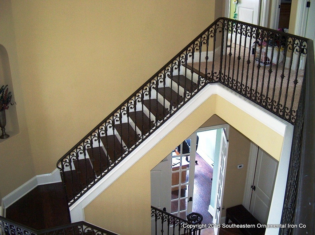 Wrought Iron Stair Railing Southeastern Ornamental Iron Works | Cast Iron Straight Staircase | Raw Iron | Dark Stain | Handle | Luxury | Spindle