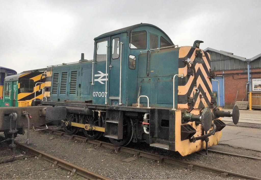 Former Southampton Docks BR Class 07 number 07007 shunts stock in Eastleigh Works yard