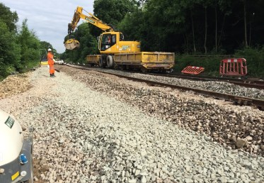 A Road Rail Vehicle working on the site of the landslip at Middlewood