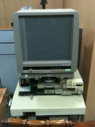 Ancient technology in the Seoul National Library. I've used something similar at Harvard's research center in Italy- I'm pretty sure it is meant to read slides or tiny photos?