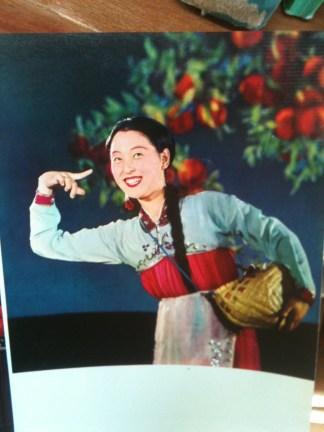 An image of North Korean woman in film or propaganda.