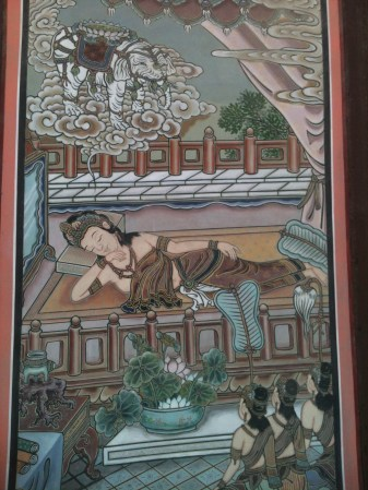 A painted wooden panel inlaid along a temple's exterior wall. There were many more, depicting various scenes of a story.