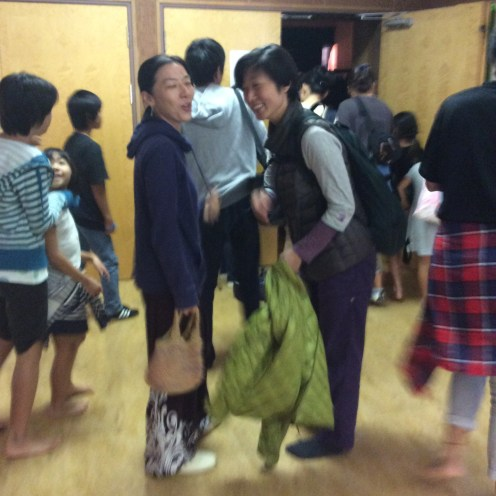 Sanae and Fumi laughing at me (with me) right before a series of dance performances by both young and old inside the gymnasium.