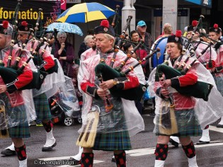 wet bagpipers parade