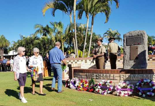 Susan Spenser and Joan Barnier from Tin Can Bay QCWA lay their wreath