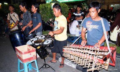 Street performers Parked motorbikes along Malioboro Street, Yogyakarta, Indonesia
