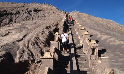Climbing the stairs to Mt. Bromo's crater in Indonesia