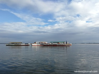 Boats waiting for their passengers to Hundred Islands National Park at Lucap Wharf