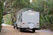 camper-trailer-entering-campsite-38282260