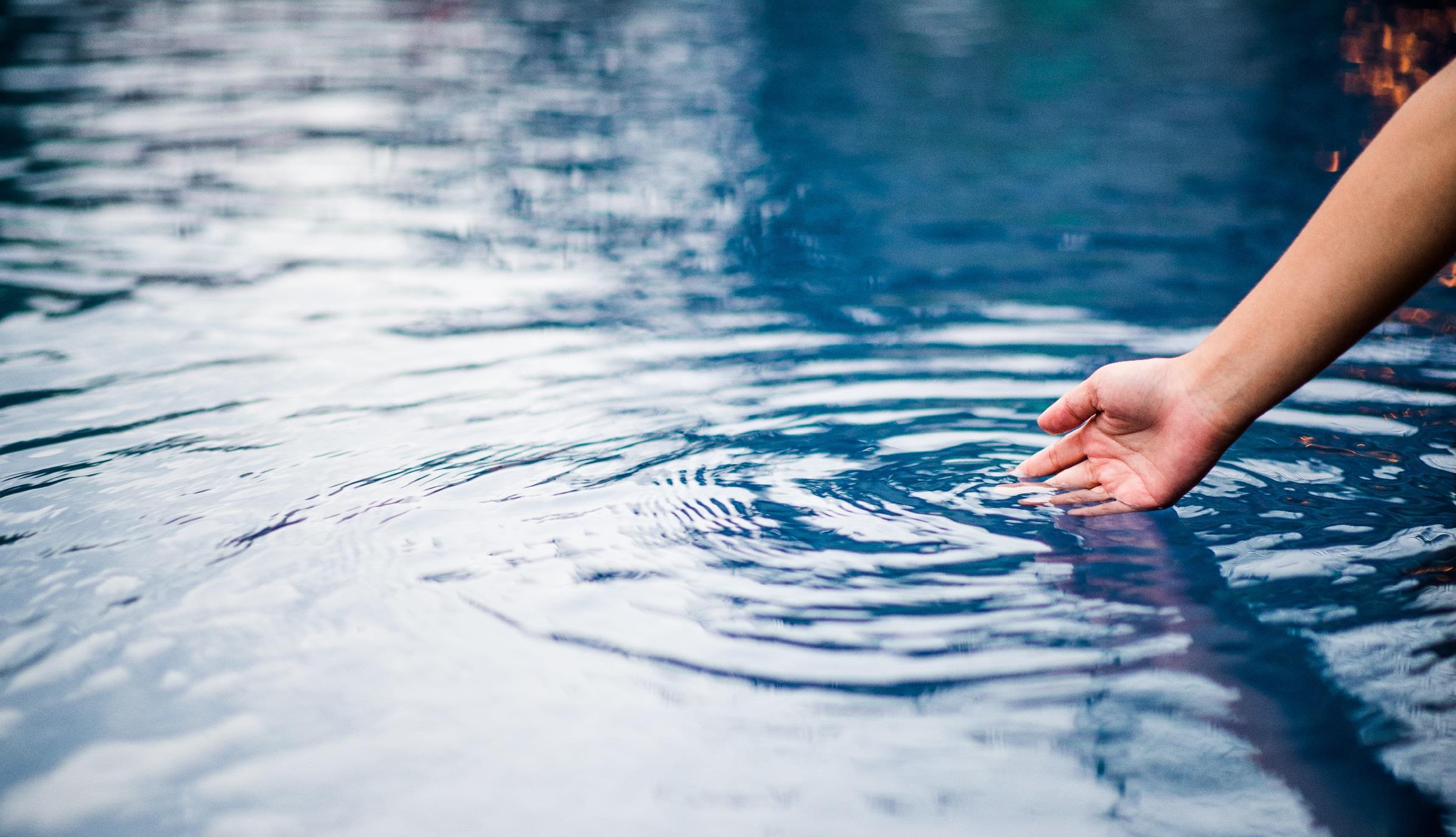 hand touching water