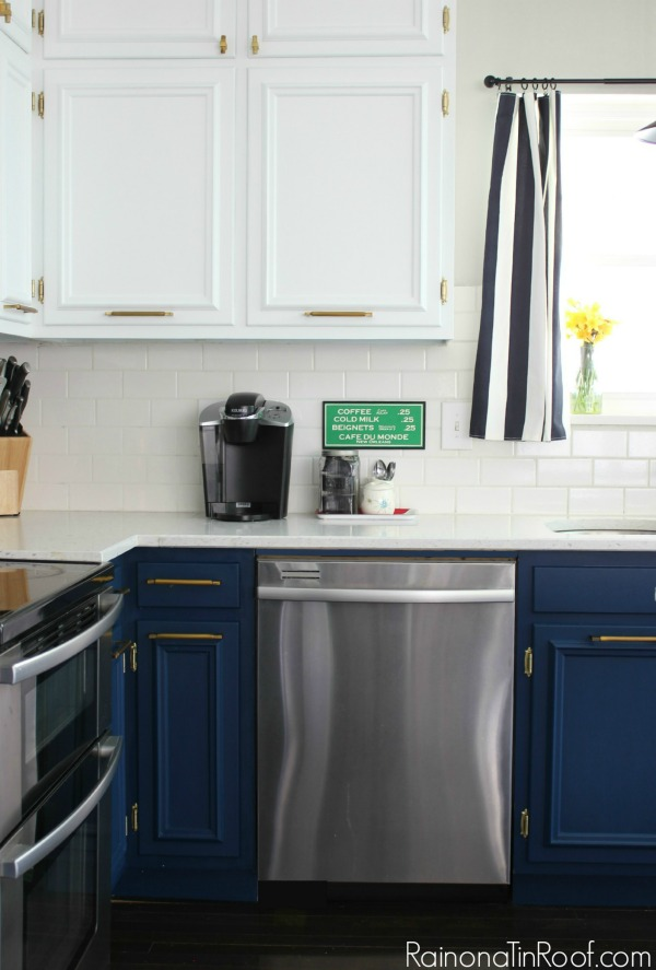 delta bronze kitchen faucet glass table sets navy and white modern