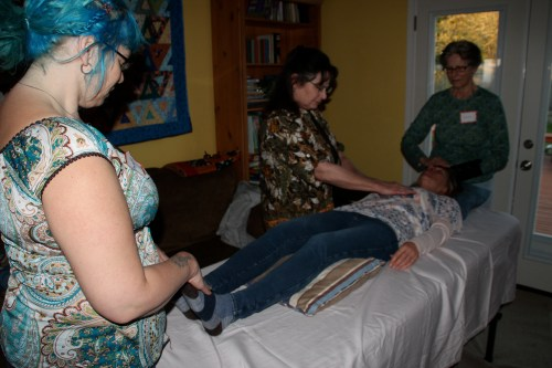 We had three rooms with a massage table in each and five people at each table.  Each group working with Reiki independently but also, I could feel the energy of all 15 of us, all working together as one, one intention, one energy, on purpose- to heal each other.