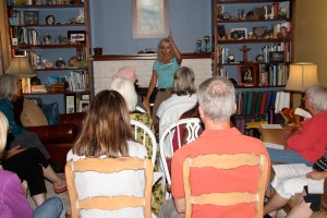 Candia talking to our group in my packed living room.