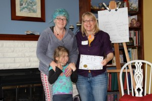Isabel and her mom Stephanie receiving her certificate.