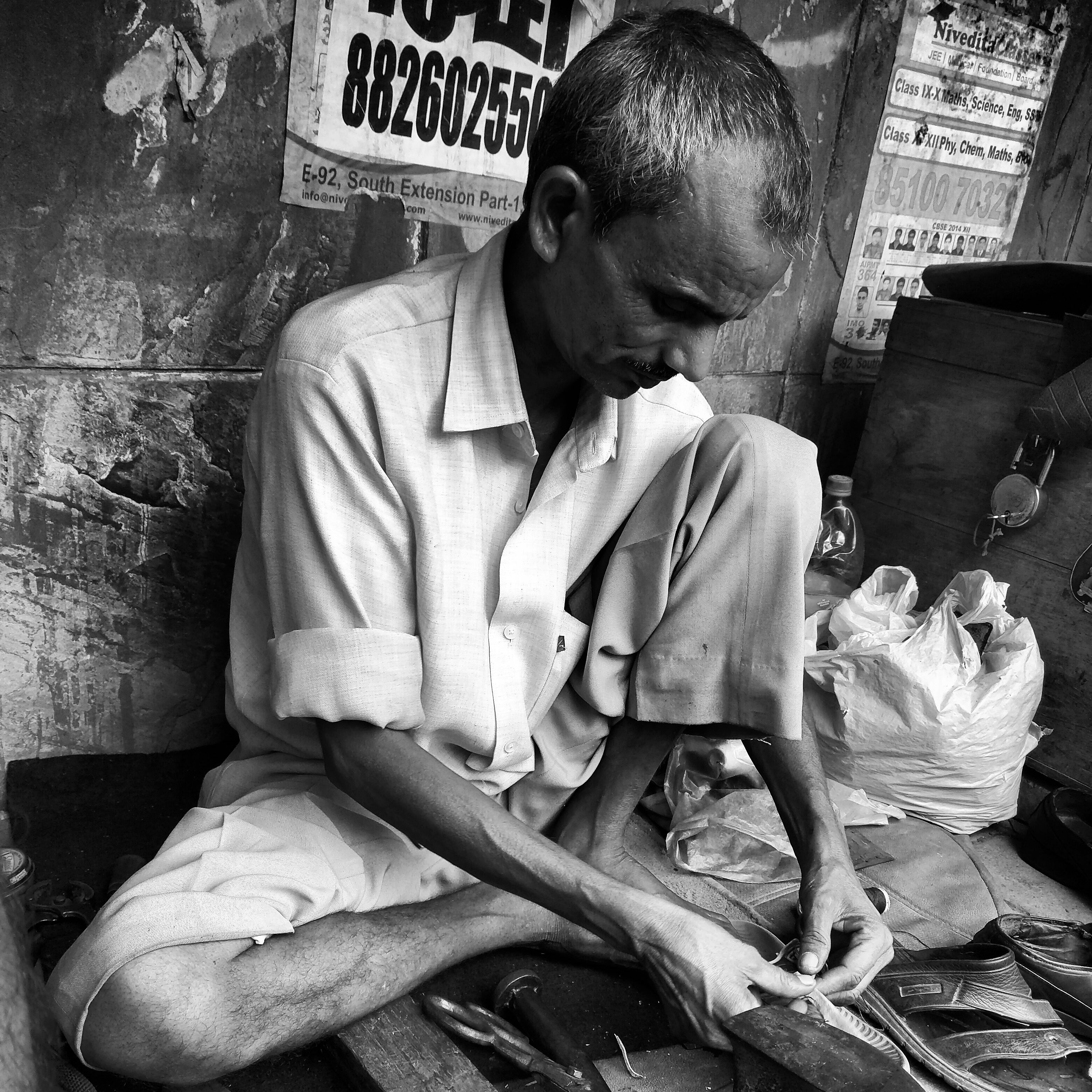 A Bihari migrant working as a cobbler in South Delhi's semi-posh Gautam Nagar locality