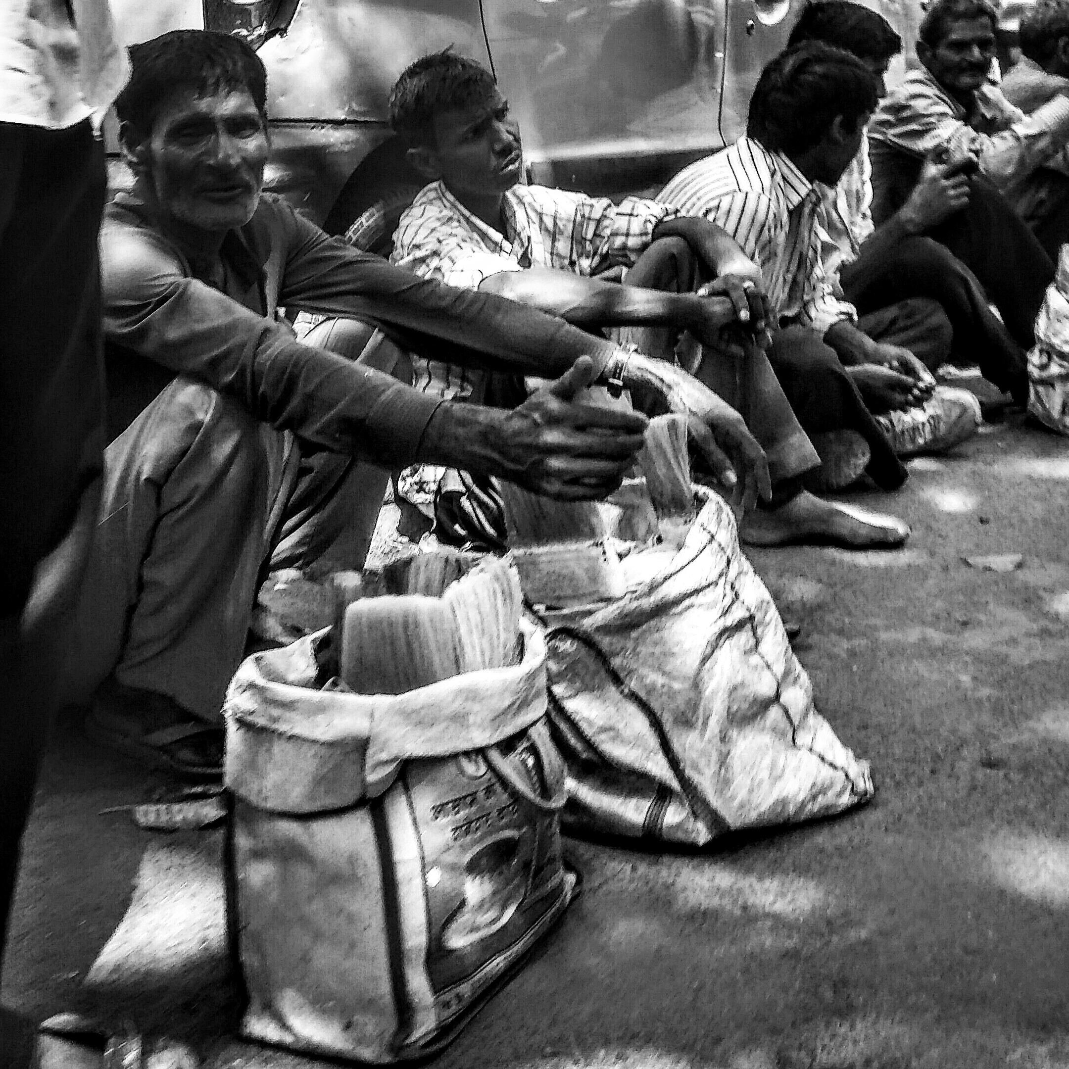 Another group of daily wage labourers wait in the sun, hoping for work. While most of them get hired on daily basis, some of them hang around for hours without any opportunity