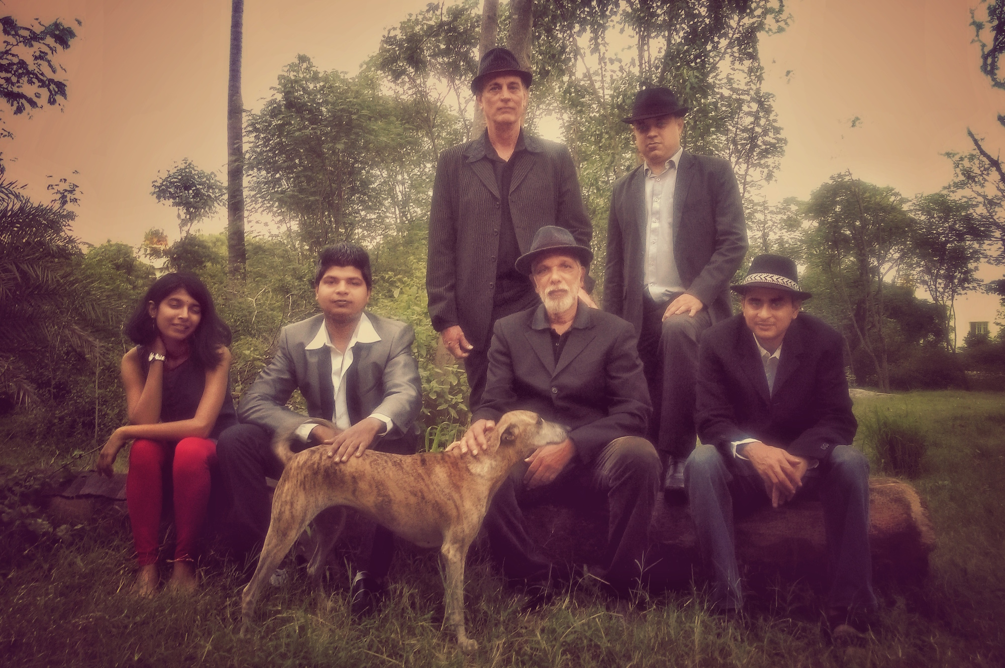 Front row, from left to right singer Rajni Shivaram; drummer Shreyas Sel; a Hoskote hound called Kutti; lead guitarist Peter Isaac; and Raveen Panday, keyboards. Back row, from left to right, Owen Bosen, electric bass; and Mukut Chakravarti, additional keyboards
