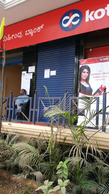 Kotak Mahindra Bank ATM. Notice the shutters completely down and the guard outside.