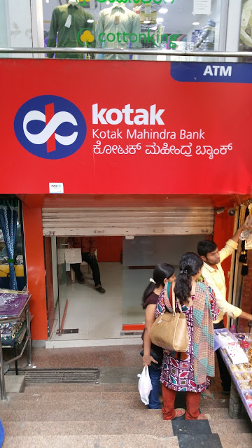 A third Kotak ATM. Note again the half shutters